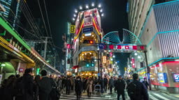 4K Time lapse of Crowd Undefined people walking around night market street at Shimbashi Station with car traffic Tokyo city, Japan. Japanese culture and shopping area concept