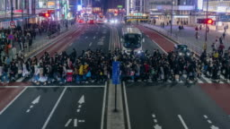 4K Time lapse of crowd undefined people walking on the street cross-walk with car traffic in Shinjuku Tokyo city at night time, Japan. Japanese culture and shopping neon street concept