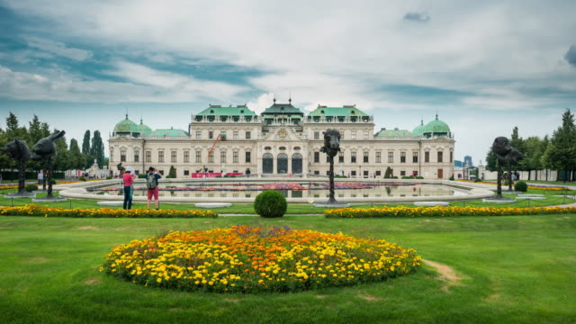 time lapse of crowd waking at belvedere palace, vienna, austria - belvedere palace vienna stock videos & royalty-free footage