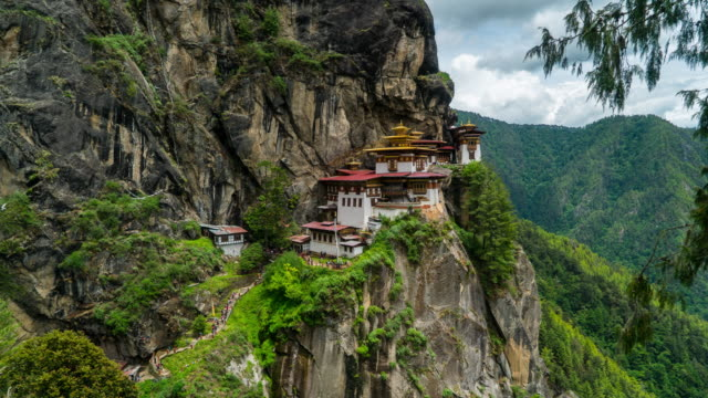 time lapse of crowd waking at tiger nest temple, bhutan - bhutan stock videos & royalty-free footage
