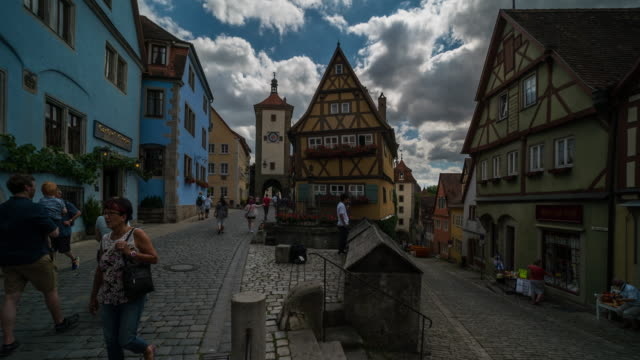 time lapse of crowd walking at downtown rothenburg odt, germany - 14th century bc stock videos & royalty-free footage