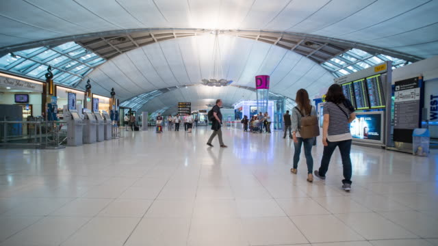 time lapse of crowd walking at suvarnabhumi airport - airline check in attendant stock videos and b-roll footage