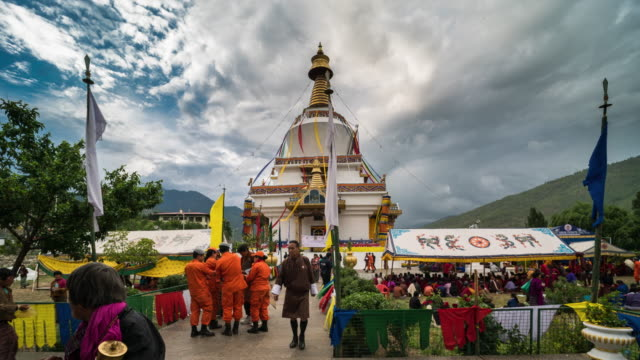 time lapse of crowd walking, tashi yangtse stupa, thimphu, bhutan - bhutan stock videos & royalty-free footage