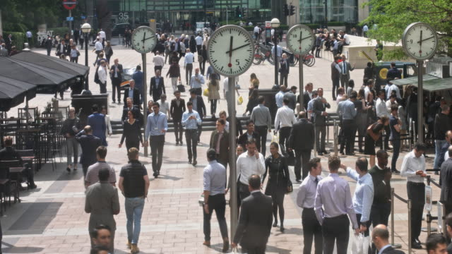 time lapse of crowds of people in canary wharf in london, uk - canary wharf stock videos & royalty-free footage