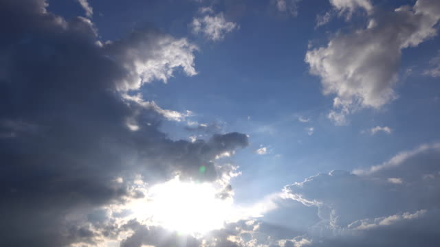 time lapse of cumulus clouds with glowing edges in the sun - storm cloud stock videos & royalty-free footage