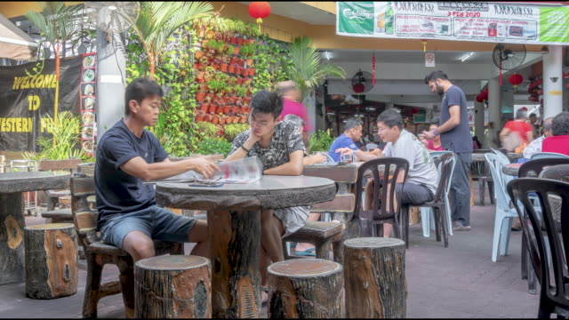 time- lapse of  customers sitting at outdoor restaurant - malaysia stock videos & royalty-free footage