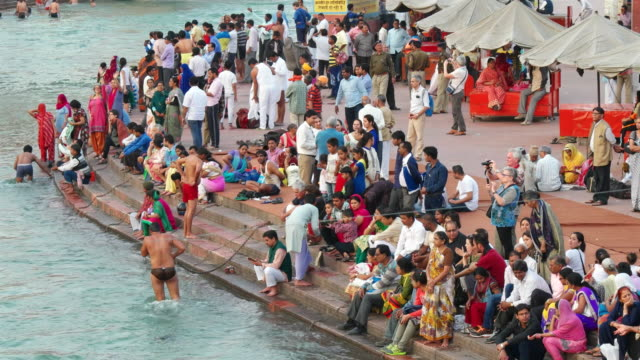 Time Lapse of devotees taking a dip in the holy waters of river Ganges in Haridwar ghats