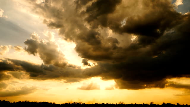 time lapse of divine light through storm clouds - raggomitolato video stock e b–roll