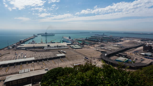 dover - circa 2012: time lapse of dover port, with cargo and ferries loading with cars and tourist going to france - dover england stock videos and b-roll footage