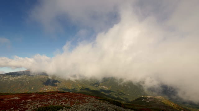 time lapse of dramatic clouds moving through on mount washington, new hamphire - spoonfilm stock-videos und b-roll-filmmaterial