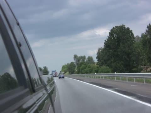 stockvideo's en b-roll-footage met time lapse of driving through mirror pal - achterstevoren