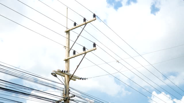 time lapse of electricity post with blue sky