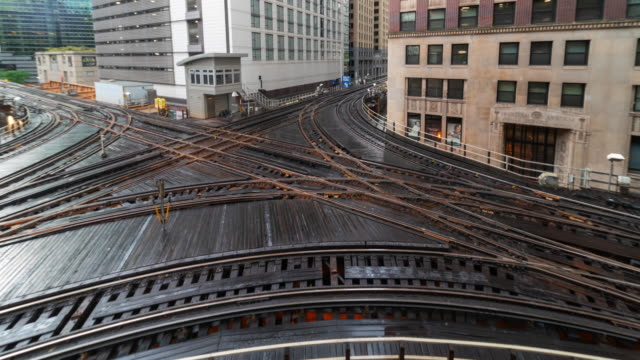 a time lapse of elevated railway train on a bridge in chicago illinois usa - elevated train stock videos & royalty-free footage