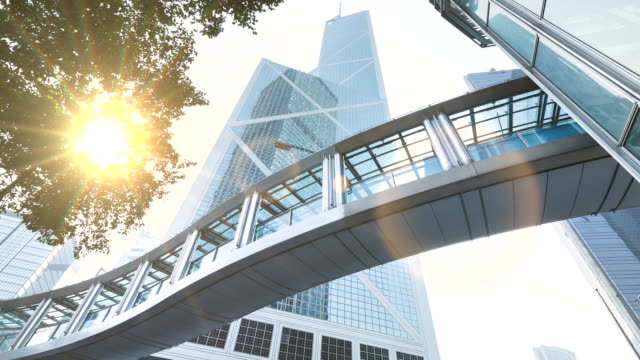 time lapse of elevated walkway central hong kong business district, zoom out - bank of china tower hong kong stock videos and b-roll footage