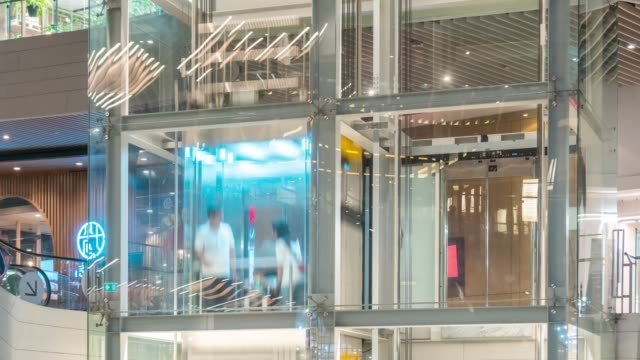 time lapse of elevators in the shopping mall,tilt down - open stock videos & royalty-free footage