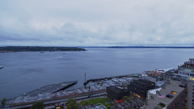W/S time lapse of Elliot Bay at twilight as dark clouds roll in with West Seattle in the background