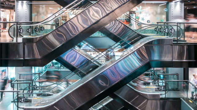 time lapse of escalators in shopping mall - escalator stock videos & royalty-free footage