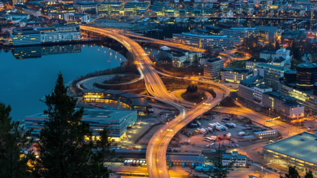 4k time lapse of express way with traffic light at the bergen cityscape at the sunset time, 4k clip - sunset stock videos & royalty-free footage