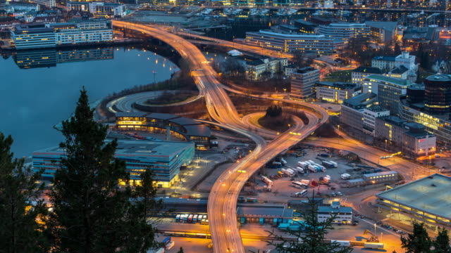 4K Time lapse of express way with traffic light at the Bergen cityscape at the sunset time