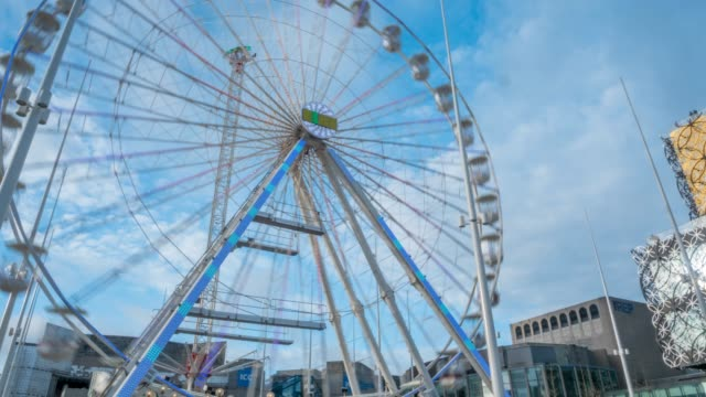time lapse of ferris wheel and public library, birmingham, england, united kingdom, europe - west midlands stock videos & royalty-free footage