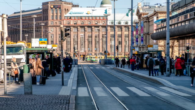 vídeos de stock e filmes b-roll de time lapse of finnish people going to work in the morning using city tram car. routine life of city people. helsinki, finland - finlândia