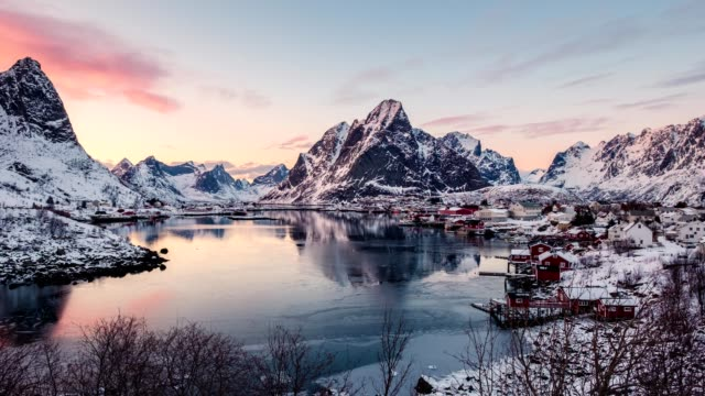 time lapse of fishing village surrounded mountains at reine - viking stock videos and b-roll footage