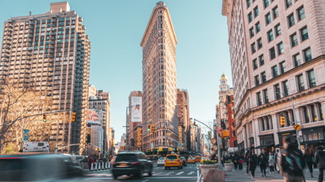 time lapse of flatiron building, new york city, united states - fifth avenue stock videos & royalty-free footage