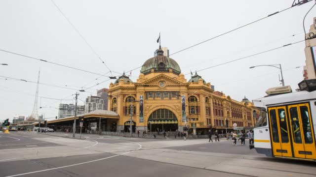 time lapse of flinders street station - melbourne, australia - public transport stock videos & royalty-free footage