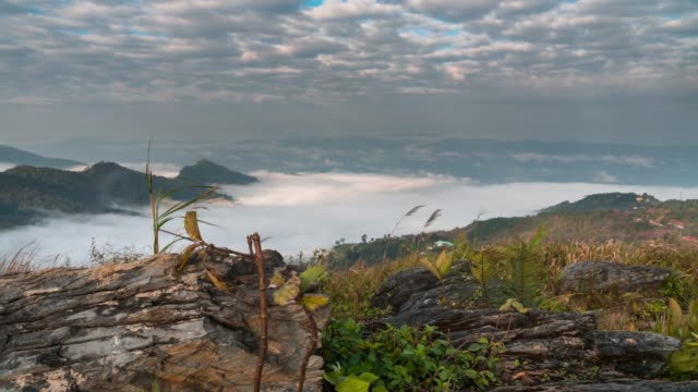 Time lapse of Fog rolls across flowing over mountains,Dolly shot