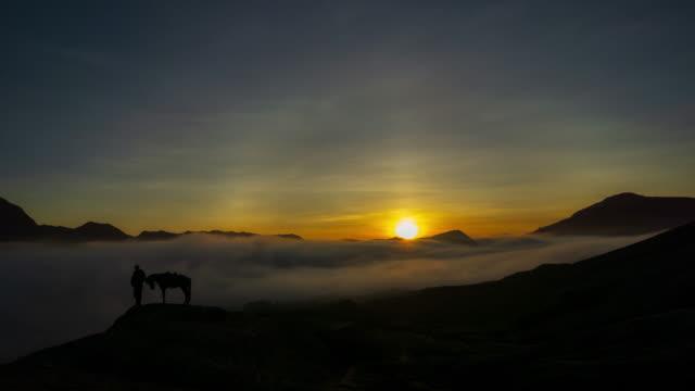4K Time lapse of foggy morning over mountain range at Mount Bromo, Semeru, Tengger National Park, Indonesia.