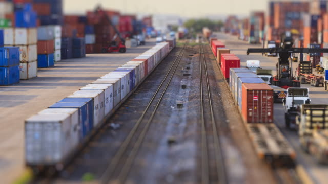 4k time lapse of freight train and logistics operation in railroad container yard. - tramway stock videos & royalty-free footage
