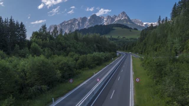 time lapse of fritzerkogel and autobahn near nischofshofen, upper austria region of the alps, salzburg, austria, europe - österreich stock-videos und b-roll-filmmaterial