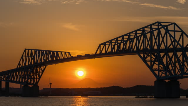 4k time lapse of fuji diamond at tokyo gate bridge reflect with the river. diamond fuji was called when the sunset connect to the  mountain which have 2 times each year for this scene, japan - tokyo bay stock videos & royalty-free footage