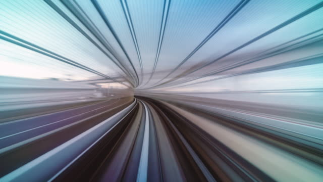 4k time lapse of futuristic scene motion blur movement from tokyo japan train of yurikamome line moving between tunnel in tokyo, japan - driverless transport stock videos & royalty-free footage