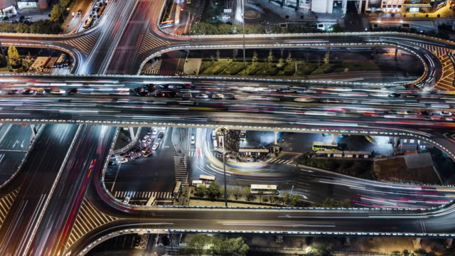 time lapse of gaumao road intersection in central beijing, aerial view - pechino video stock e b–roll