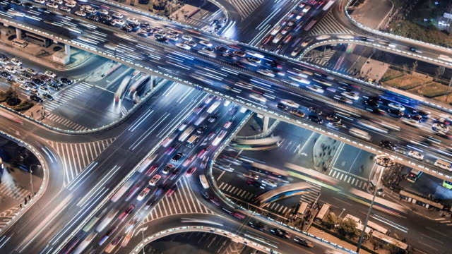 time lapse of gaumao road intersection in central beijing, aerial view - peking stock-videos und b-roll-filmmaterial