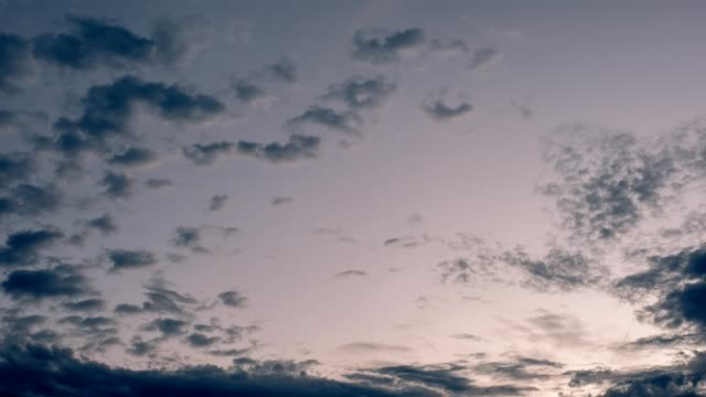 time lapse of gloomy clouds floating on sky at sunset - condensation stock videos and b-roll footage