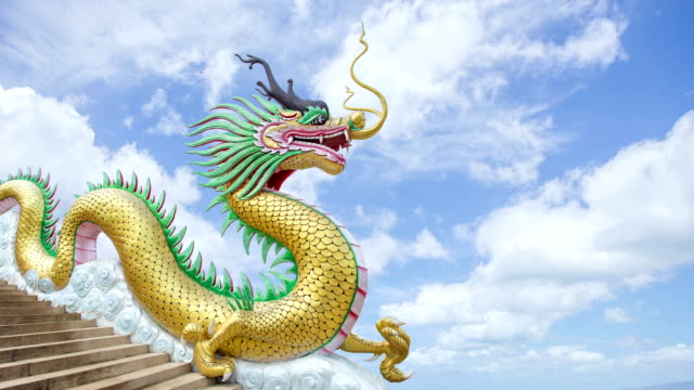 time lapse of golden dragon with clouds move over - dragon stock videos & royalty-free footage
