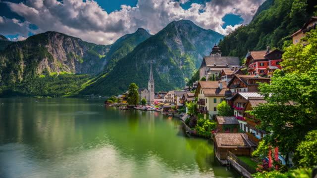 time lapse of hallstatt mountain village in austria - salzkammergut stock videos and b-roll footage