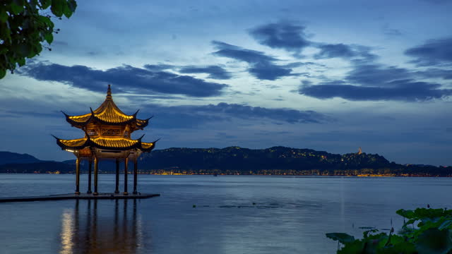 time lapse of hangzhou west lake at dusl - pagoda stock videos & royalty-free footage