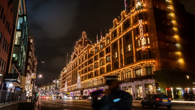 LONDON - CIRCA 2012: Time lapse of Harrods decoration during christmas time and traffics, in London