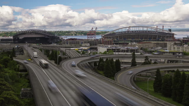 W/S time lapse of highway traffic in southern Seattle with CenturyLink and Safeco fields in the background