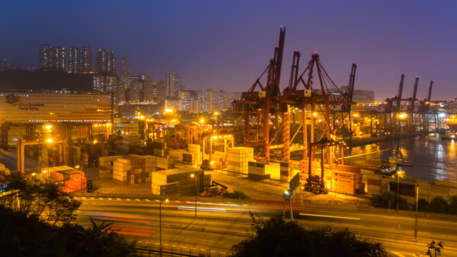 time lapse of hong kong container port, day to night - efficiency stock videos and b-roll footage