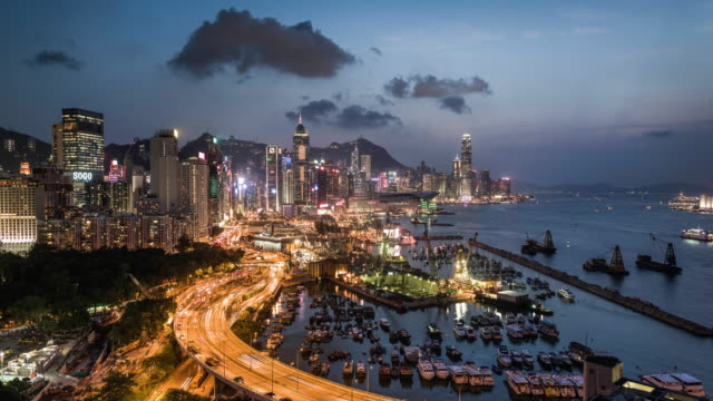 time lapse of hong kong island skyline and financial district - ferry terminal stock videos & royalty-free footage