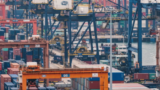 4k time lapse of hong kong port cargo transshipment hub and container transportation - chinese culture stock videos & royalty-free footage