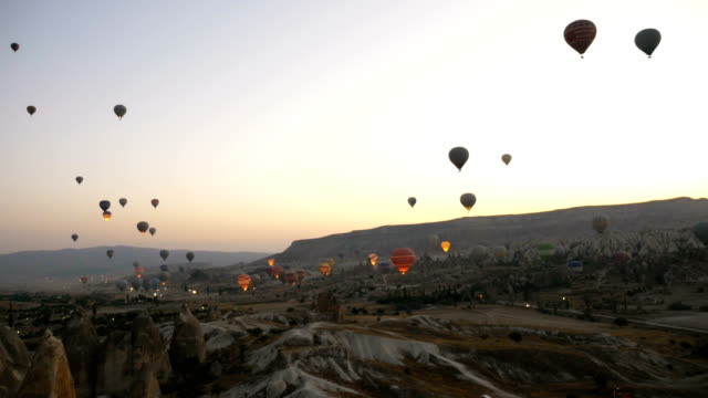 time lapse of hot air balloons flying over the goreme  at cappadocia - hot air balloon stock videos & royalty-free footage