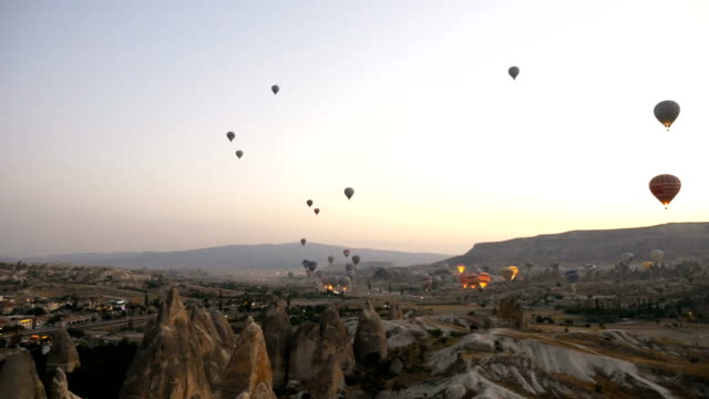 Time lapse of hot air balloons flying over the Goreme  at Cappadocia