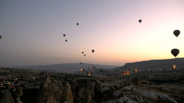 time lapse of hot air balloons flying over the goreme  at cappadocia - turkey middle east stock videos and b-roll footage