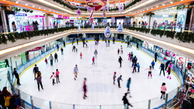 time lapse of ice skating rink inside shopping mall with skaters - ice rink stock videos and b-roll footage