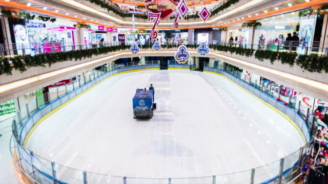 time lapse of ice skating rink inside shopping mall with skaters - ice rink stock videos & royalty-free footage